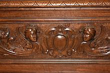 A fine quality Italian walnut cassone having carved decoration and supporte