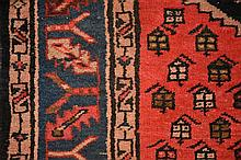 A hand woven Persian floor runner with geometric decoration. Length 302cm,
