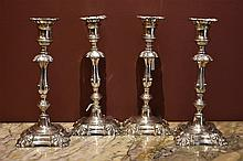 A rare set of four Continenatl silver candle sticks. Height 25cm, Width 11c