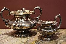 An English Continental silver creamer and sugar bowl. Height 15cm, Width 22