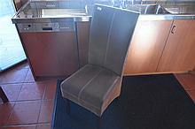 A fine set of eight leather and cane dining chairs. Height 105cm, Width 42c