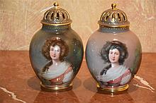A fine pair of Royal Vienna lidded vases with gilt highlights and hand pain