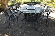 A large quality outdoor garden table with lazy susan. Height 80cm, Width 24