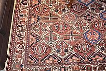 A lareg Persian pure wool hand woven carpeyt with geometric decoration. 304