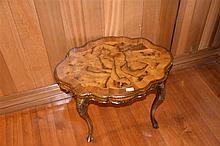 A good quality oyster walnut serpentine shaped occasional table. Height 49c