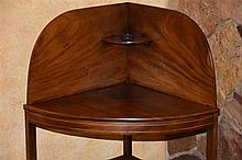 A superb and rare English 18th century mahogany corner wash stand with bras