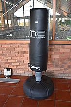 An upright boxing bag with boxing gloves. Height 170cm, Width 65cm