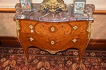 A good French 19th century kingwood bombe shaped commode having floral marq