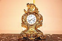 A superb tall French 19th century ormolu mantel clock with floral decoratio