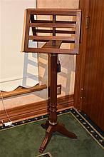 A mahogany and brass inlayed music stand. Height 145cm, Width 43cm