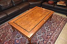 A good quality Fruit wood coffee table supported on cabriole legs. Height 4