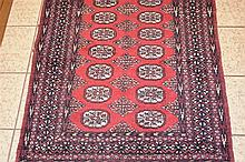 A hand woven pure wool Persian carpet with geometric decoration. Length 155
