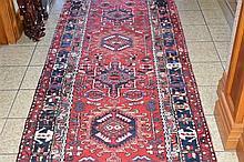 A superb hand woven pure wool persian floor runner having geometric decorat