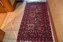 A hand woven pure wool Persian carpet having geometric decoration 226cm*104