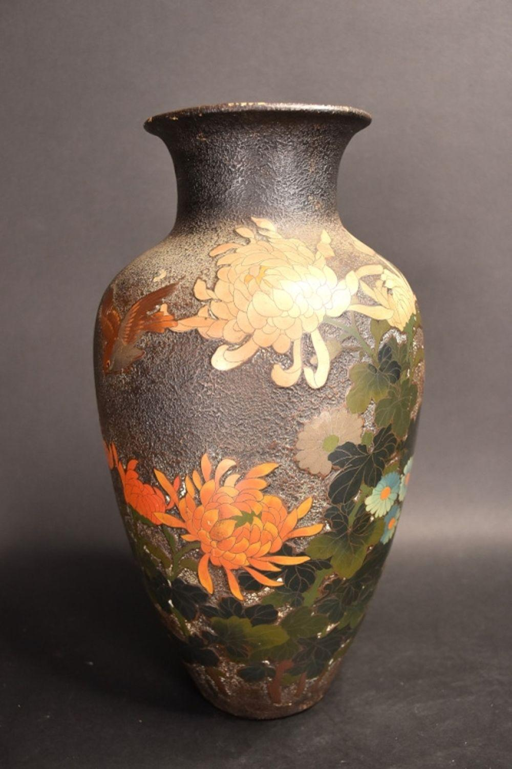A Japanese porcelain vase with raised bird and flo…
