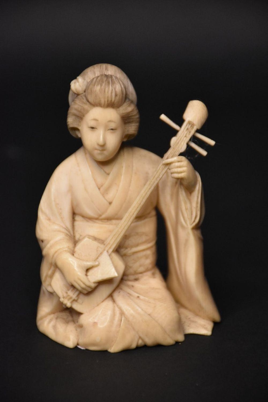 A fine Japanese Meiji period antique ivory figure …
