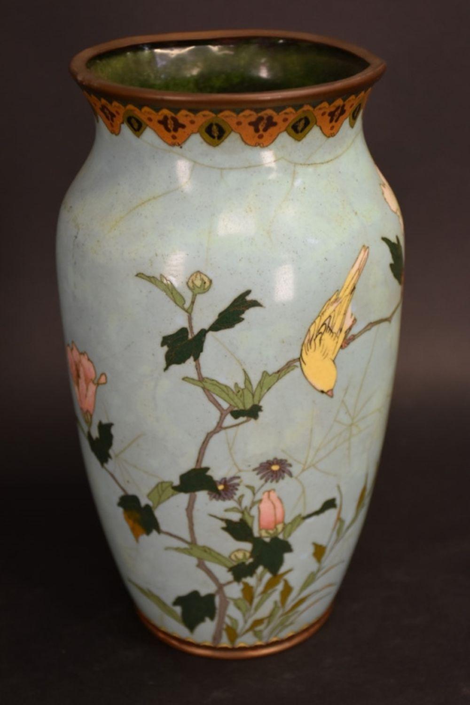 A Japanese Cloisonne vase with floral decoration. …