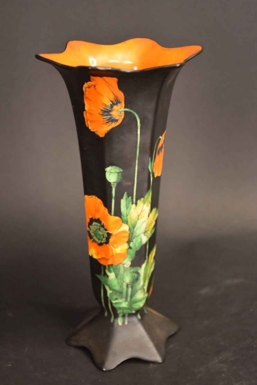 An English Ducal Ware porcelain vase on black grou…