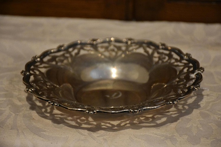 A good English 19th century Sterling silver serving dish hand raised floral decoration. Height 6cm, Width 27cm