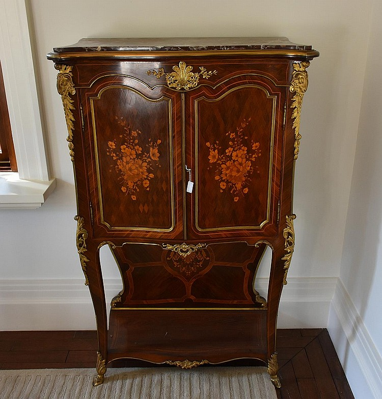 A most outstanding French 19th century kingwood two door cabinet having the finest floral marquetry inlay, ormolu mounts, marble top and a fully fitted interior. Height 141cm, 90cm