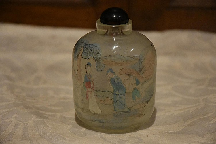 A Chinese rock crystal snuff bottle having painted interior.