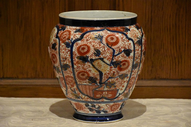 A nice Japanese Meiji period Imari vase having hand painted floral decoration. Height 20, width 18cms.