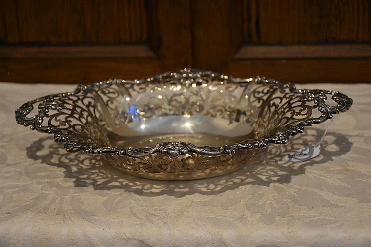 An English 19th century Sterling silver serving dish having pierced border decoration. Height 3cm, Width 17cm