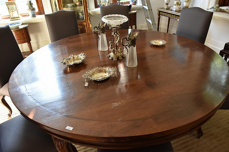A wonderful large French provincial style walnut circular dining table supported on hand carved cabriole legs. Height 78cm, Width 196cm