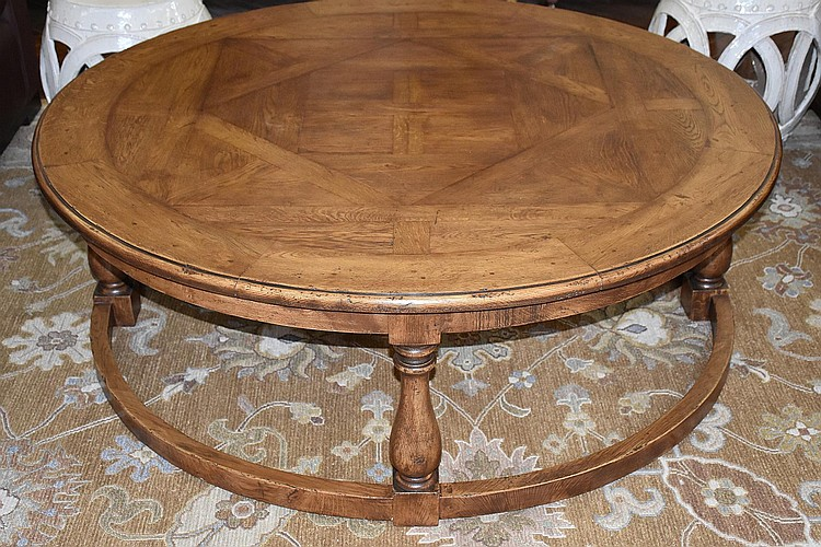 A superb French provincial style oak circular coffee table, supported on turned legs and a stretcher base. Height 51cm, Width 147cm