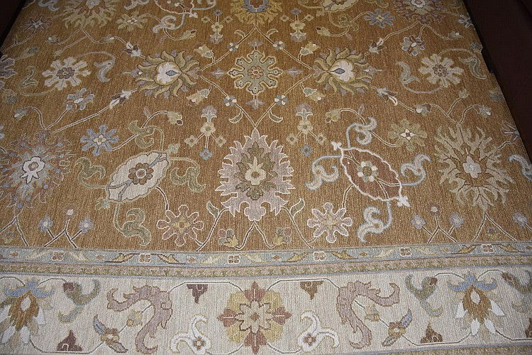A fine pure wool Persian carpet having all over floral decoration. Length 365cm, Width 272cm