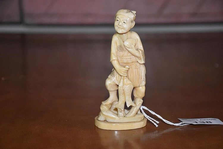 A good Japanese Meiji period okimono of the successful fisherman, signed to base. Height 10cm, Width 5cm