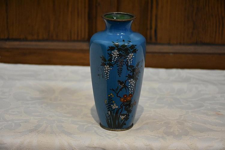 A Japanese 19th century light blue cloisonné vase having bird and cherry blossom inlay. Height 15cm, Width 8cm
