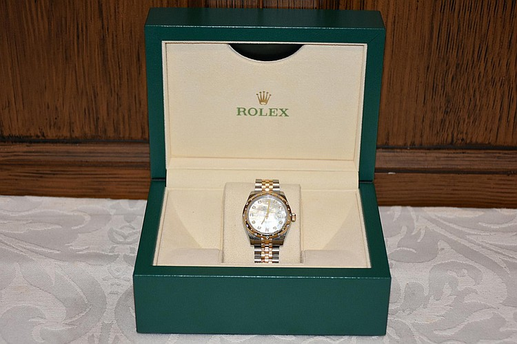 A fine Rolex ladies watch with oyster perpetual movement and diamond jewelling.