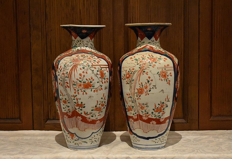 A good pair of Japanese Meiji period Imari Vases with hand painted bird and floral decoration. Signed to the base. Height 37, width 17cms.