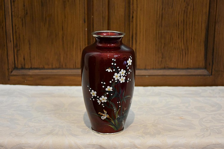 A Japanese cloisonné red ground vase having floral inlay