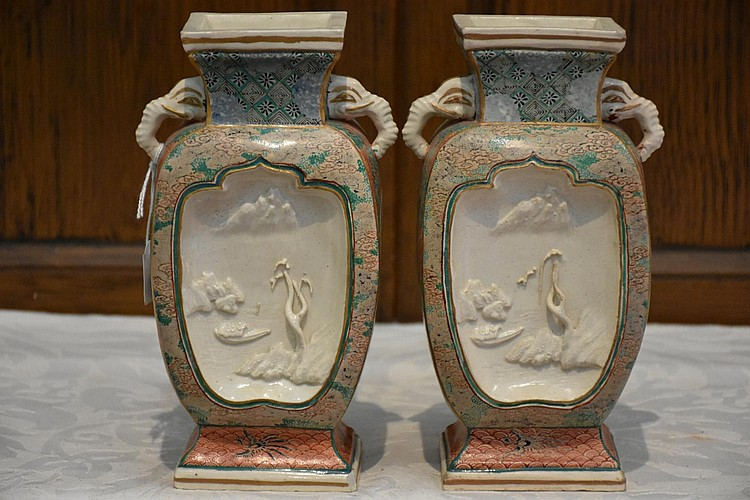 A good pair of Japanese 19th century earthenware vases having all over floral decoration and elephant handles. Height 21cm, Width 11cm