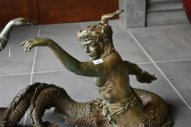 A cast iron outdoor table base, comprising two mythical figure supports