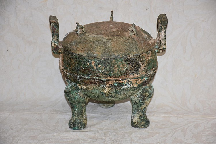 A rare Chinese archaic lidded bowl.