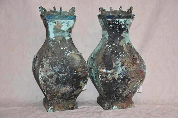 An Archaic pair of Chinese bronze lidded vases.
