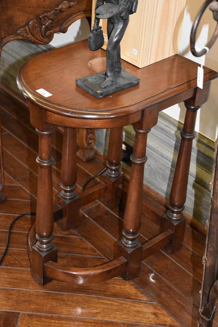 A pair of French provincial walnut bow fronted occasional tables supported on turned legs and having a stretcher base. Height 63cm, Width 37cm