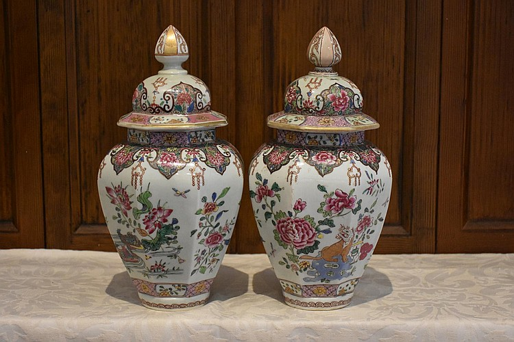 A pair of French 19th century hand painted lidded vases having all over floral and gilt decoration. Height 34cm, Width 16cm