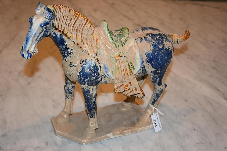 A Chinese earthenware figure of a horse. Height 31cm, Width 34cm
