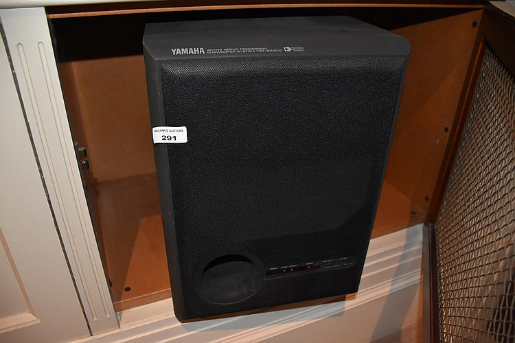A Set of 5 Yamaha speakers, three surround sound and two sub woofers. Model number YST-SW500.