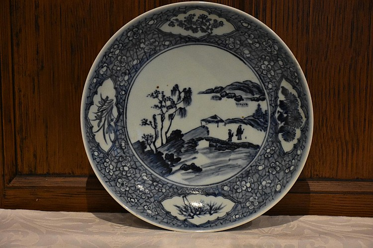 A Chinese blue and white hand painted bowl having village in landscape decoration, signed to base. Height 5cm, Width 27cm