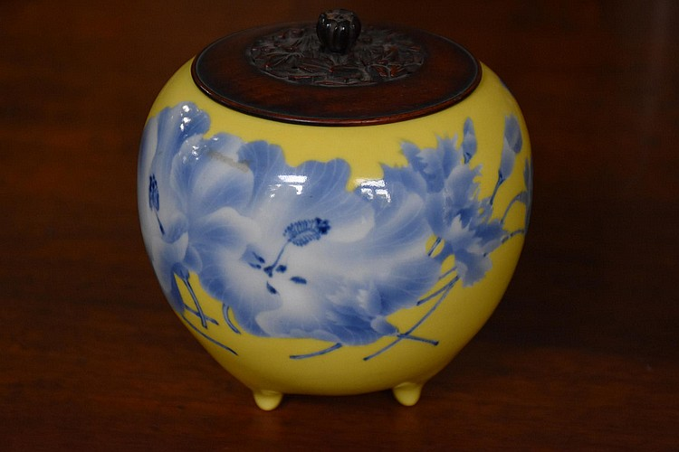A good Chinese hand painted yellow ground ginger jar having floral decoration and Cherrywood lid, signed to base. Height 14cm, Width 14cm