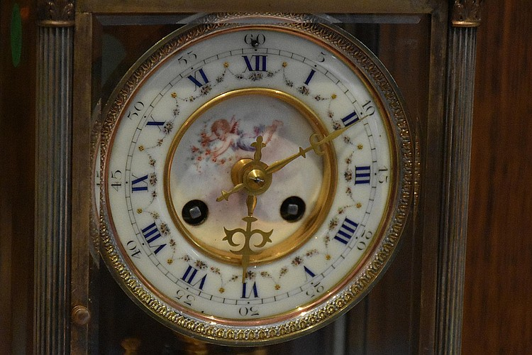 A fine French 19th century four glass brass salon clock having hand painted enamel dial with cherub decoration and original mercury compensated pendulum. Height 34cm, Width 21cm