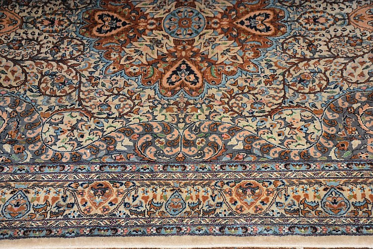 A fine pure wool Persian carpet having all over floral decoration. Length 226cm, Width 140cm