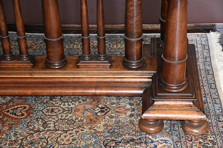 A world class French 18th century walnut centre of the room table, having superb turned columns and supported on a stretcher base. Height 76cm, Width 230cm