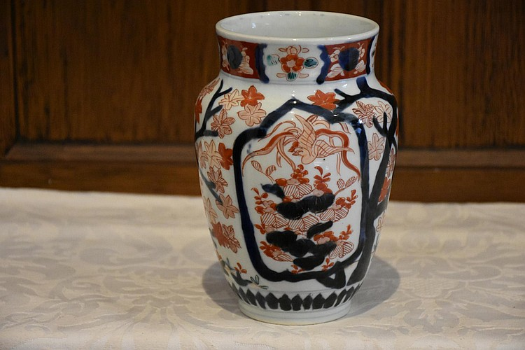 A Japanese 19th century hand painted Imari vase having all over hand painted floral decoration. Height 18cm, Width 12cm