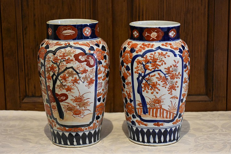 A good pair of Japanese 19th century hand painted Imari vases having all over floral decoration. Height 26cm, Width 15cm